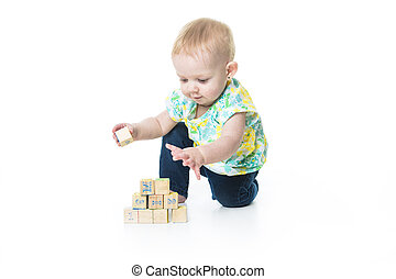 Happy kid playing toy blocks  isolated on white background