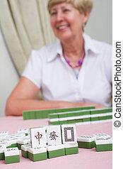 happy mahjong player