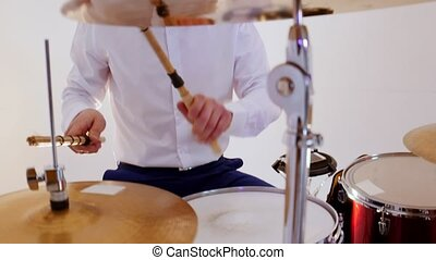 A happy man drummer from the musical band playing song in ...