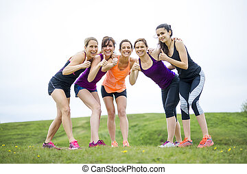 Happy running team on the grass