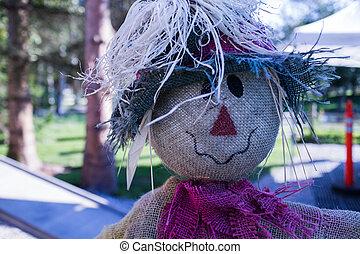 happy scarecrow on farm