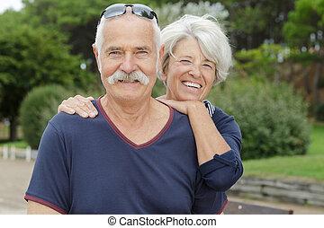 a happy senior couple outdoors