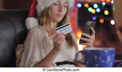 A happy shopper finishes her online purchase on her phone - dolly push in