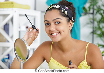 a happy woman and make-up master corrects