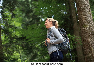 Happy Woman hiking in a forest