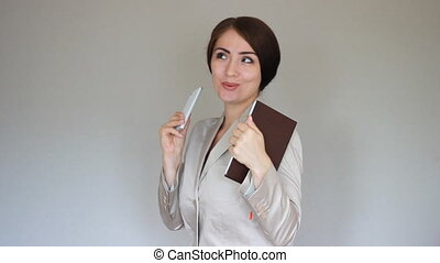 A happy young business woman enjoys success and victory. The concept of business