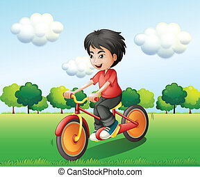A happy young man biking