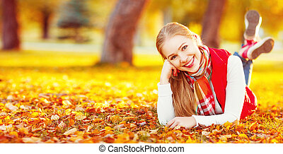 happy young woman resting outdoors in autumn