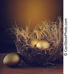 A Hay Nest with 3 golden Eggs.