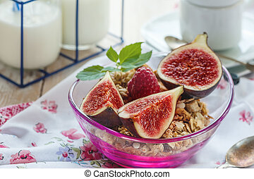 A healthy Breakfast of figs, cereals and fruit with nuts and mint. Close-up.