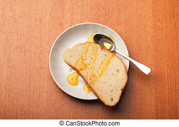 A healthy Breakfast with bread and honey .