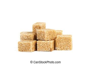 A heap of brown sugar cubes
