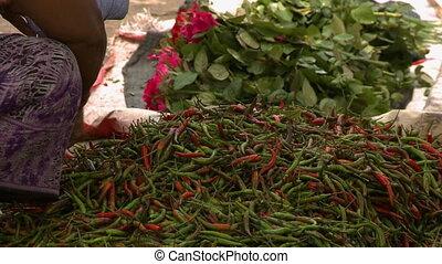A heap of green and red pepper - A close up shot of a heap...