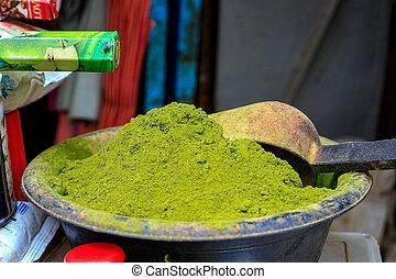 A heap of light green henna powder in a market stall in Mekn?s