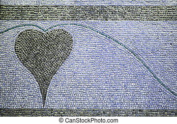 A heart designed with stones on the ground;