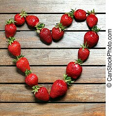 a heart made of strawberries