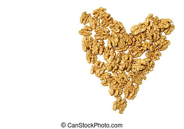 a heart of walnuts on a white background