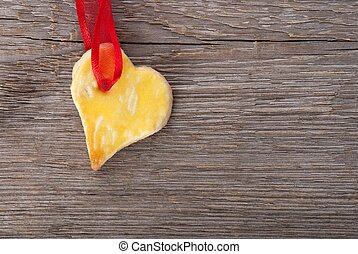 a heart on wooden background