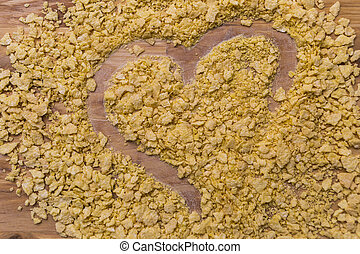 A heart shape made in cereal on a table