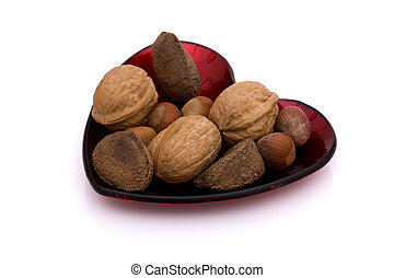 A heart shaped dish of healthy mixed nuts