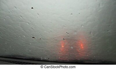A heavy downpour with hail from the car window