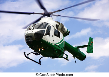 helicopter - a helicopter in the air while flying