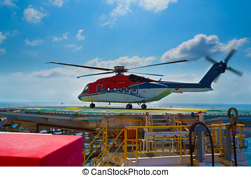 a helicopter landed on offshore drilling rig