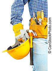 a helmet in hand of worker