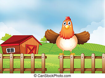 A hen above the fence with a wooden house at the back
