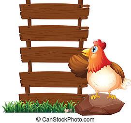 A hen beside the empty signboards