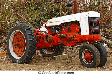 A high contrast shot of an old large orange and antique...