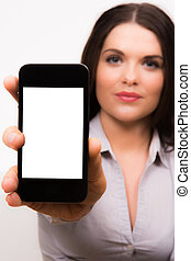 A high resolution image of a Business women and iPhone
