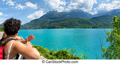 hiker woman watching view of Lake Annecy