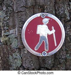 A hiking trail marker