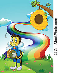 A hilltop with a rainbow and a bee near the beehive