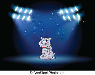 A hippopotamus at the stage with spotlights