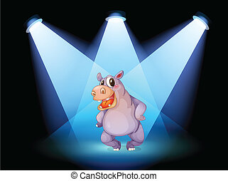 A hippopotamus standing at the stage with spotlights
