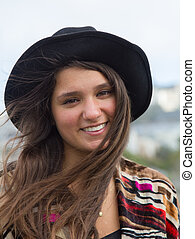 A hippy girl in San Francisco wearing a hat