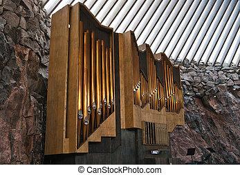 A historic pipe organ in church in rock