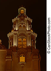 A historical church's steeple at Parque Kennedy in the main tourist district Miraflores (Lima, Peru) photographed at night