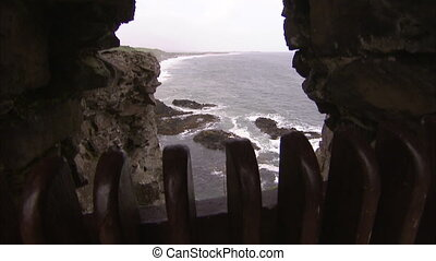 A hole to the shore - A tilt up shot from an opening that...