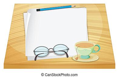 a, holztisch, mit, ein, leerer , papier, und, a, tasse tee
