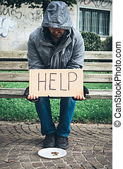 A homeless begging money because poor