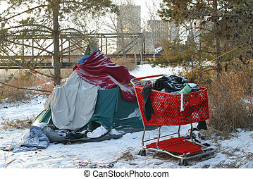 A homeless person's tent and shopping cart are seen in Edmonton, Alberta, Canada.