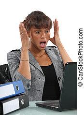 A horrified black businesswoman.