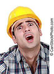 A horrified tradesman