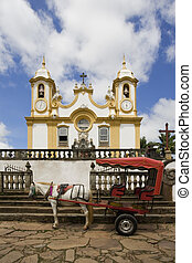 Tiradentes - A horse drawn carrage sits in front of Igreja...