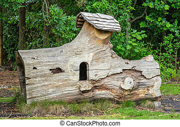 A house in the forest made of a large old log