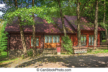 A house in the woods. A beautiful house in the middle of the forest.