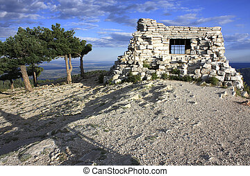 A house of stone on top